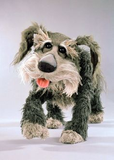 Sprocket is an intelligent sheepdog owned by Doc on Fraggle Rock. He spends much of his time in Doc's Workshop, where his bed and food dish are, observing Doc at work. As a result, he often catches Gobo in the act of retrieving a discarded postcard from Uncle Traveling Matt.