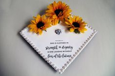 Grad cap accented with pearls and quote: She is clothed in strength and dignity & she laughs without fear of the future.  Jostens Black Graduation