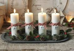 Advent candles in a pretty metal tray with pinecones. Christmas centerpiece idea for coffee table or maybe in the dining room. Christmas Advent Wreath, Xmas Wreaths, Christmas Candles, Christmas Centerpieces, Christmas Tree Toppers, Christmas Art, Advent Candles, Christmas Decorations For The Home, Diy Weihnachten