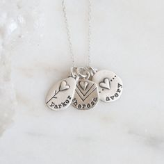 Oh so sweet! Celebrate love with this artisan necklace. Each charm reflects deep sentiment and can be personalized with a name or date.
