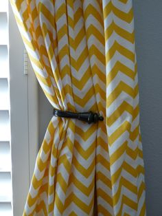 I LOVE my yellow chevron curtains. I thought the design would be too much but they're a perfect accent in our bedroom!