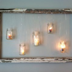 Old window with hanging mason jars and candles. My husband brilliant idea!
