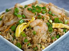 P.F. Chang's Shrimp Fried Rice   1/4 teaspoon fine ground mustard 1/4 teaspoon minced ginger 1/2 teaspoon minced or crushed garlic 1 teaspoon molasses 1 1/2 teaspoon lite soy sauce (more added at table as desired) non-stick cooking spray 1/3 cup egg substitute Salt and pepper, to taste  4 tsp canola oil 1 1/2 C cooked large shrimp from frozen, packed 3/4 C green peas, frozen (or bean sprouts) 3/4 C baby carrots, cut into matchstick or thin strips 2 C steamed rice 3 green onions, chopped