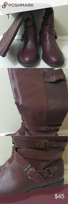 NWT Torrid Burgandy Wide calf boots/knee length Torrid wide calf boots with elastic at the back with buckles and straps around the ankle. Never worn, has a small scrape on back of heel. The white marks on the back of the soles is just a little of the sticker tag left on it. Knee length torrid Shoes Winter & Rain Boots
