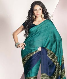 Find a whole new dimension for ethnic wear with fashionandyou.com as it brings to you a lavish collection of fabulous sarees by Brijraj. Featuring exquisite craftsmanship and beautiful colours, each piece from this line is pure joy for a perfect traditional diva. BRAND: BrijrajCATEGORY: Saree with Unstitched BlouseARTICLECOLOURMATERIALLENGTHSareeTeal and BluePoly Georgette with Satin5.40 metersBlouseBluePoly Georgette0.80 meterWe would always want to send you what we showcase but there might…