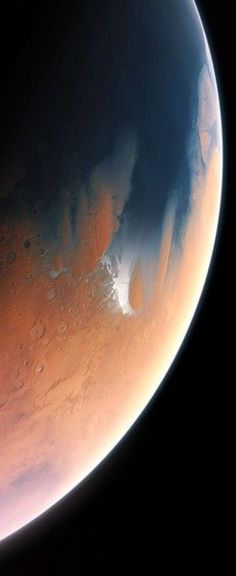 Artists impression of Mars 4 billion years ago. A primitive ocean on Mars held more water than Earth's Arctic Ocean, and covered a greater portion of land mass than the Atlantic Ocean, according to new results (March 5, 2015)