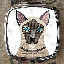 Popular dog breeds in the quirky collage style of artist Simon Hart.