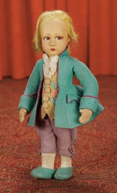 Italian Felt Portrait Doll of Mozart,Model 1933 Mozart is wearing his original green felt coat with dark-purple felt lining,yellow vest with applique flowers,ruffled organdy jabot,lavender breeches,green felt shoes