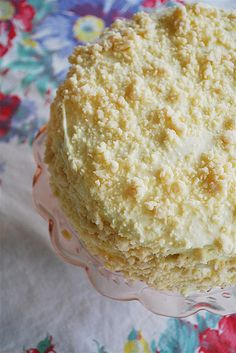The cake is also frosted with this filling and then a crumb mixture of butter, flour, powdered sugar and vanilla that is pressed over the top and sides of the cake