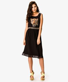 A semi-sheer midi dress featuring a leopard graphic at the front. Round neckline. Sleeveless. Darted bust. Semi-sheer chiffon skirt. Shirred elasticized waist. Partially lined. Woven. Lightweight.