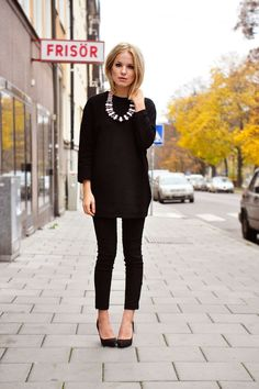 Black with statement necklace... so classic that it is reminiscent of a modern day Audrey Hepburn...