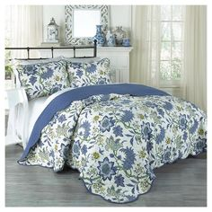 """Breathe new life into your bedroom décor with the Traditions by Waverly Maldives 3-Piece Quilt Collection. This beautiful ensemble features an updated floral pattern in rich blues and greens on an ivory ground. Scalloped edges on the quilt and shams add charm and style. Set includes one quilt and two coordinating pillow shams. Full/Queen set measures 90"""" x 90"""" with two 20"""" x 26"""" shams.  King set measures 104"""" x 90"""" with two 20"""" x 36"""" shams..."""