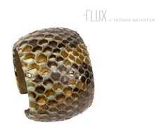 Gorgeous Python leather bangle $320  Courtesy of A Cuckoo Moment.