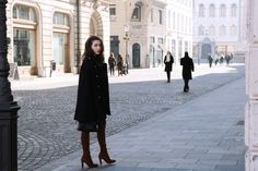 Fashion blogger Veronika Lipar of Brunette From Wall Street sharing the chic way to wear a floral suit and the OTK boots