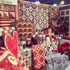 My Cottage Fair quilt design in the center.  Thank My Red Door Designs for kitting my Quilts Remembered pattern. www.myreddoordesigns  our booth for road to California 2014. Booth 1021/23
