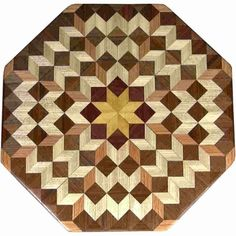 """This is my """"Medium Carpenters Wheel"""" Lazy Susan. The measurements are 15 1/2"""" across (17"""" tip to tip) and 2"""" high. This lazy susan has 5 kinds of wood, all the natural colors. There are 464 pieces in the overlay, 136 diamonds and 328 triangles. The type of wood used is listed on the bottom from the center out. On this lazy susan, starting from the center is """"Satinwood"""" from Brazil, """"Purpleheart"""" from Central or South America, """"Hackberry"""" """"Oak"""" and """"Walnut"""" from Missouri, The pattern is b..."""