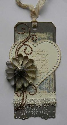 Idea for those chipboard flowers I have ...