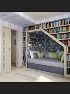 Sleeping nook. Look at all the great storage! Bookcases surrounding this built-in captains bed.