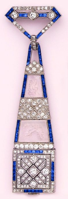 Calibré-cut sapphire, diamond, carved rock crystal intaglio and platinum pendant watch.