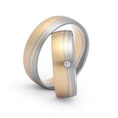 Trauringe in 585 Gelbgold / 950 Palladium mit 0,02ct Brill. TWSI Ringform: außen abgerundet, innen bombiert. Damenring, Herrenring