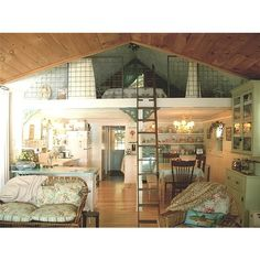 I totally love the loft bedroom in this. very cozy --- perhaps if I were a writer this is what my haven would look like.