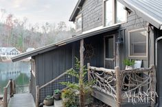 The former 1930s fishing cottage, fronted with wooden clapboard, cedar shingle siding and handcrafted twig railings, looks at home on Lake Burton yet belies its chic interiors.