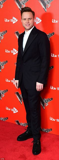 Suited and booted: New judge Olly Murs - who was suave in a fitted black suit - seemed in ...