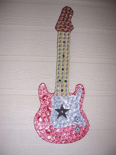 Guitar beer bottle cap art. Check us out on Facebook!