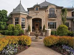 Gorgeous Tuscan styled home....pretty stone...lots of plants....love!!!