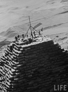 Members of the Adventurers' Club of Denmark joyfully dancing on top of a pyramid in Egypt.