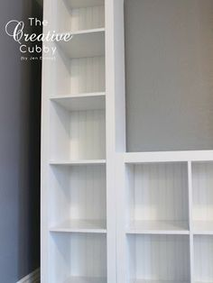 IKEA Expedit Makeover - Painted old bookshelves white and added beadboard to the back to create a built in media center.