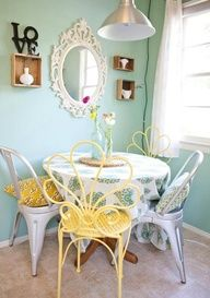 """Pretty little table with mismatched chairs give this dining """"nook"""" personality!"""