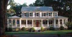 This nearly symmetrical home is the picture of Southern life. The wraparound covered porch spans the entire front and side of the home; another porch can be accessed from the kitchen.