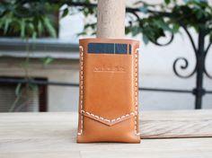 iPhone 5 leather case handstitched tan color. $29.00, via Etsy.