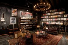 Amazing Vinyl Wall Collection Hanging Guitars Chandeliers Record Players, Amps, Couches. Radness!
