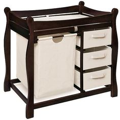 Furnish a nursery with this multitasking, sleigh-style espresso changing table. Constructed of wood, it features a changing platform with safety rails, a pullout ecru canvas hamper bag, and three ecru canvas pullout basket drawers with handles.