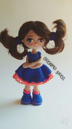 Amigurumi crochet doll little girl in blue dress