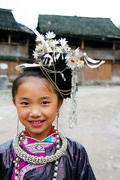 Chinese girl in Miao Minority costume