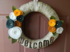 Spring Wreath - Welcome Sign - Summer Wreath - 14 Inch Yarn Wrapped Wreath with Felt Flowers, Pearls and Leaves. $38.00, via Etsy.