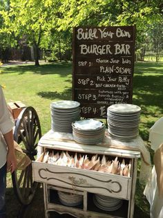 China plates, wooden-ware for utensils tied together with twine and a gourmet burger bar...super rustic and casual meets super fancy = Perfect Country Chic Wedding