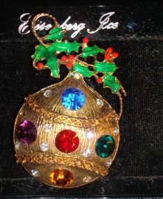 Lovely Eisenberg Ice Christmas pin is still on original card. Ornament pin measures 2.25 inches tall and is about 1.5 inches wide at its widest point.