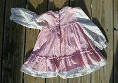 Late 70s Pink Calico Toddler Dress  Darling pink and white calico floral print dress that looks like the classic pinafore, but is all one piece. Cuteness includes lace trim, pink ribbon at the chest, and a three button back.  Brand: My Very Own 50% Polyester, 50% Cotton Tag Size: 4T (please check measurements below for a sure fit)  ~~Measurements~~ Bust ♥ 23 Waist ♥ 26 (open) Length ♥ 17  If you have any questions or would like to see more photos, please dont hesitate to message me.