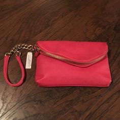Charming Charlie's Clutch Charming Charlie salmon clutch with wristlet and shoulder strap. New with tags. Charming Charlie Bags Clutches & Wristlets