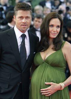 Angelina Jolie and Brad Pitt confirmed that they were expecting twins in May 2008 while attending th. Angelina Jolie Pregnant, Brad Pitt And Angelina Jolie, Jolie Pitt, Red Slip Dress, Black Sequin Dress, Jennifer Aniston, Celebrity Couples, Celebrity Photos, Pregnant Celebrities