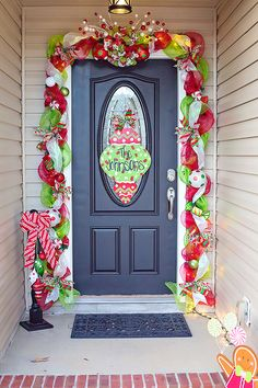 Mesh garland around our front door. whimsical door. Christmas gingerbread. Candy. Mesh swag.