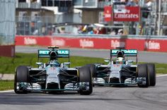 Nico Rosberg and Lewis Hamilton driving Mercedes at the 2014 Canadian Grand Prix.