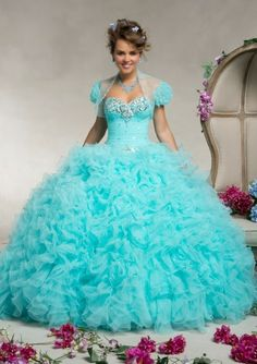 is a cyan colored dress with a heart-shaped decoration flowers on the part of Ariba and also has some silver dots with a cyan colored collar also contains a small transparent vest their price is four hundred seventy-three