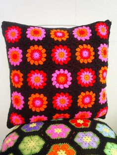Granny square cushion cover by riavandermeulen, via Flickr