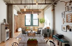 Returning from Washington, D.C., to their native Illinois, Homepolish's Jennifer Talbot helped Jamie and Tyler transform a 1903 West Loop industrial space into a rustic yet chic condo. See how you can get the look. #Safavieh #Homepolish