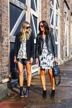 Elle and Tash from @TheyAllHateUs rocking monochrome prints and the leather at MBFWA #streetstyle